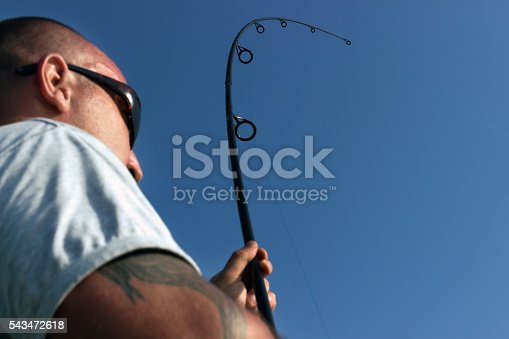 1145410808 istock photo Young man fishing, Fisherman holding rod in action 543472618