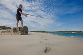 A young adult fishing at Hamelin Bay in Western Australia, a popular destination in Autumn for the Salmon migration.