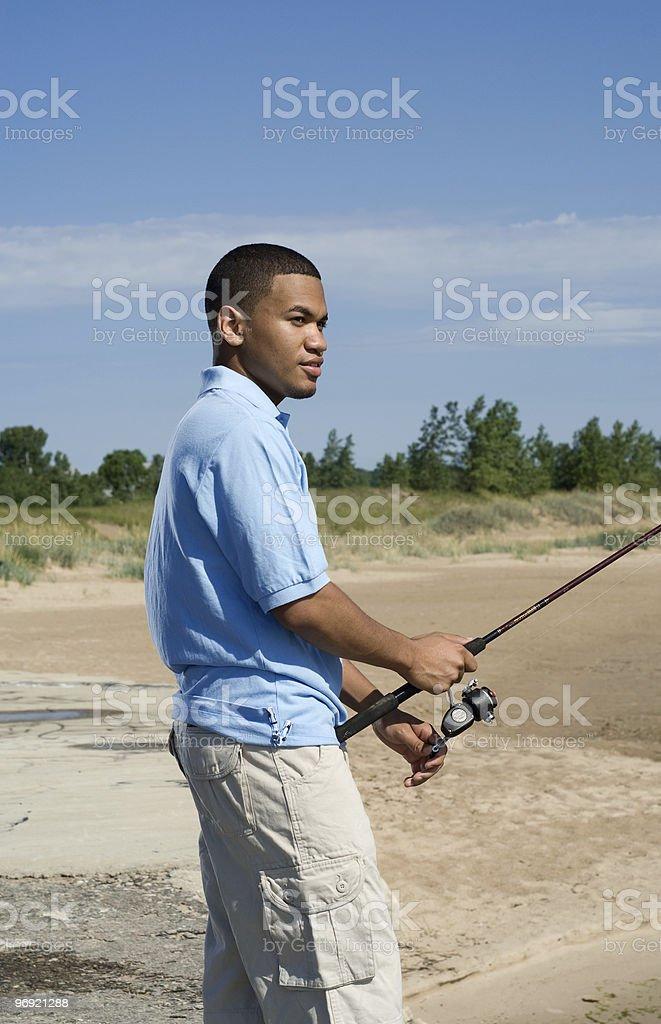 Young man fishing royalty-free stock photo