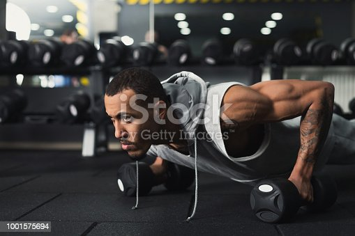 istock Young man fitness workout, push ups or plank 1001575694