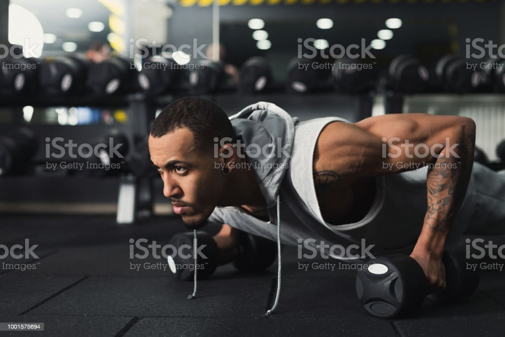 Young man fitness workout, push ups or plank stock photo