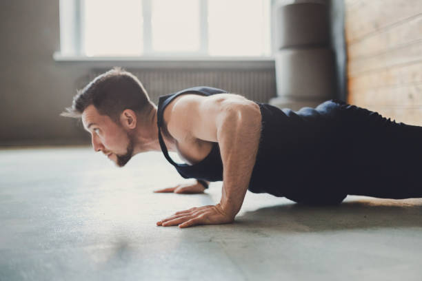 young man fitness workout, push ups or plank - push up stock photos and pictures
