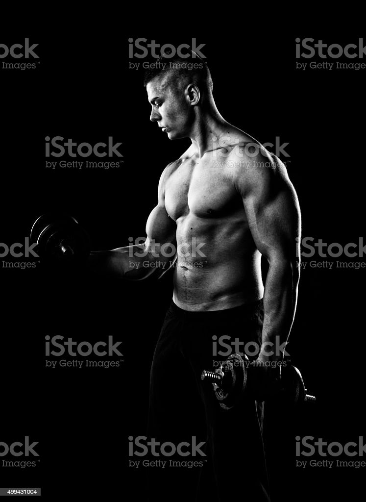 young man flexes his bicep stock photo