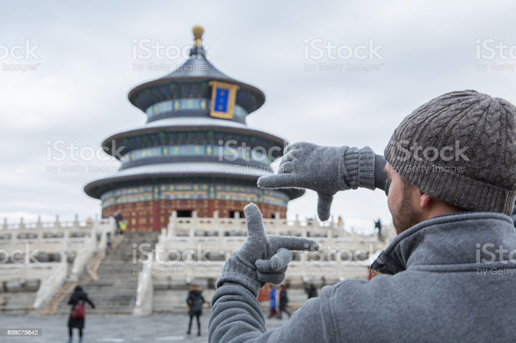 Young man framing the Temple of Heaven, Beijing stock photo