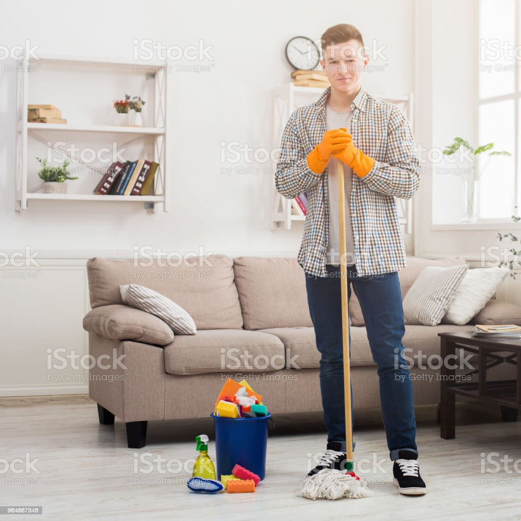Young man from cleaning service at home royalty-free stock photo