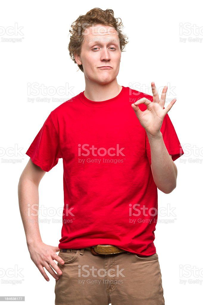 Young Man Gestures Okay Hand Sign stock photo