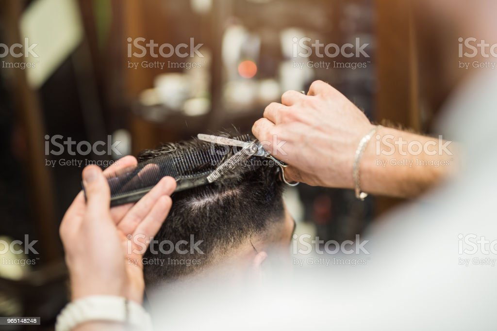 Young man getting a cool haircut. zbiór zdjęć royalty-free