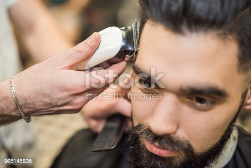 622527180istockphoto Young man getting a haircut. 965145608