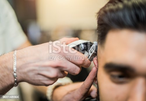 622527180istockphoto Young man getting a haircut. 965148564