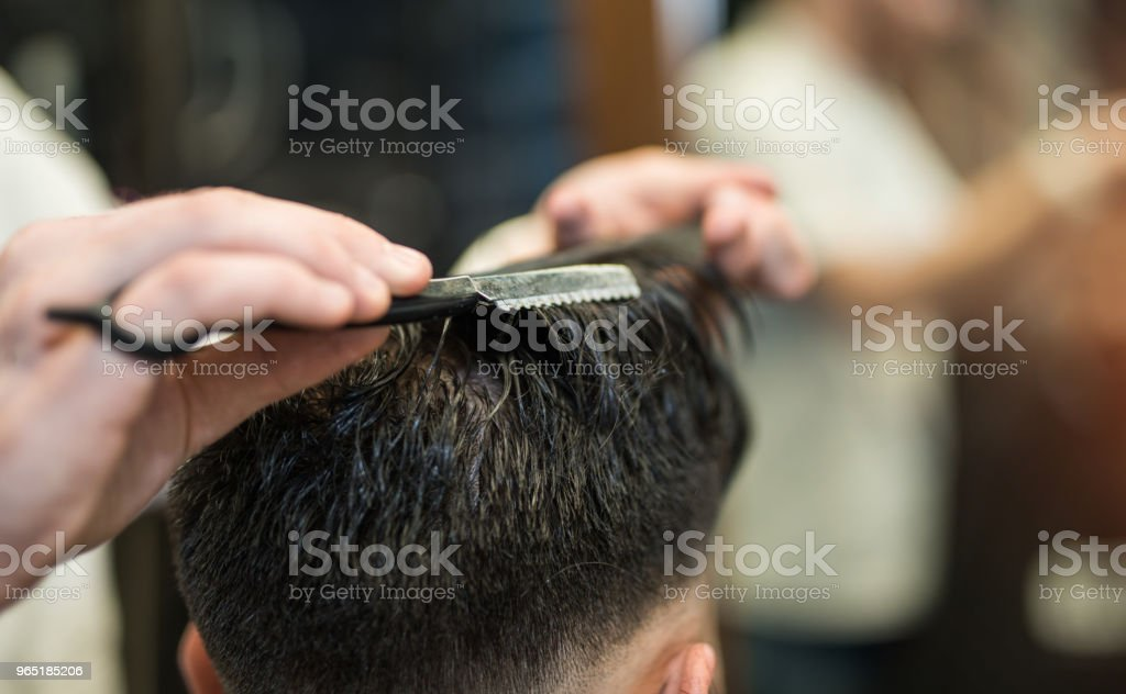 Young man getting a haircut. royalty-free stock photo