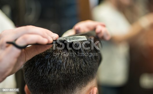 622527180 istock photo Young man getting a haircut. 965185206
