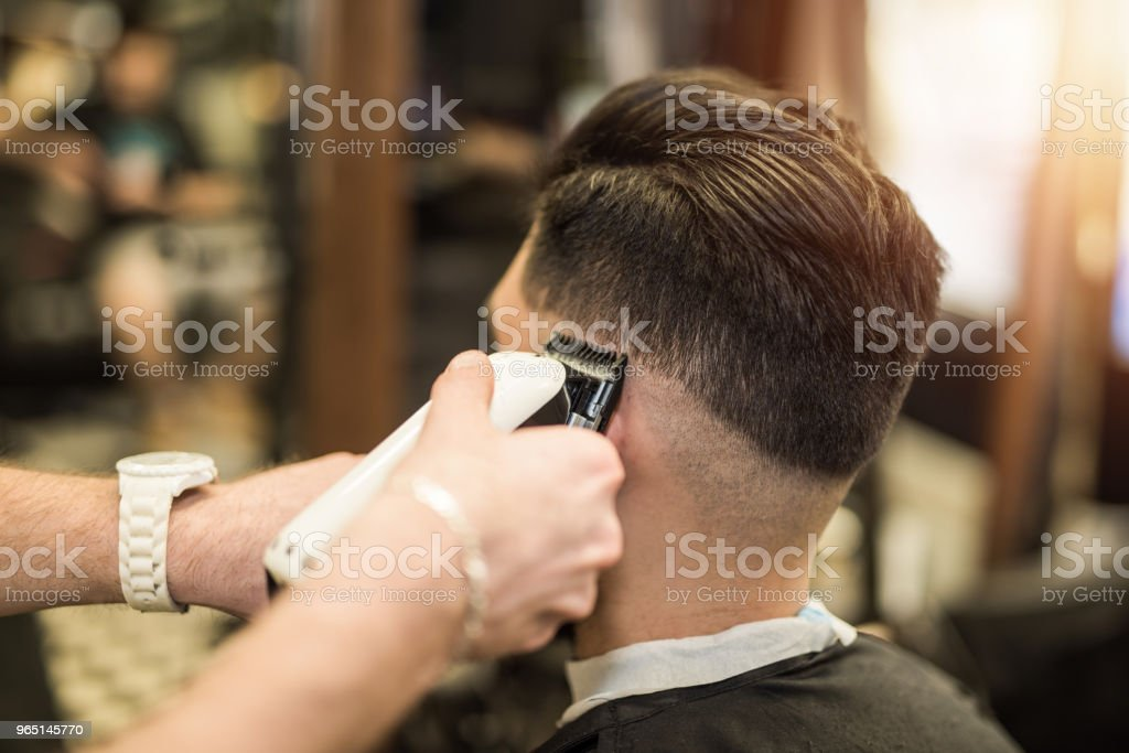 Young man getting a modern haircut. royalty-free stock photo