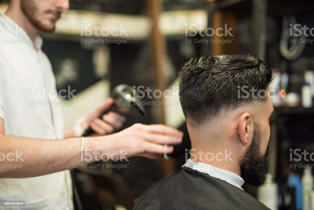 Young man getting cleaned up after getting a great haircut. royalty-free stock photo