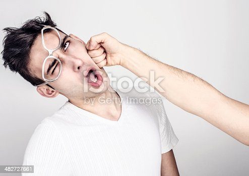 istock Young man getting punched in the jaw. 482727661