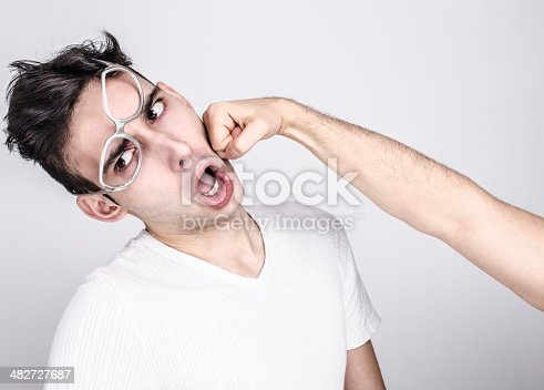 istock Young man getting punched in the jaw. 482727687