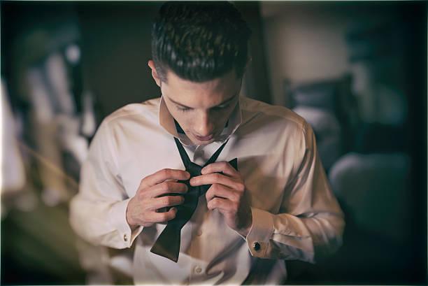 young man getting ready for his wedding - angst vor der geburt stock-fotos und bilder