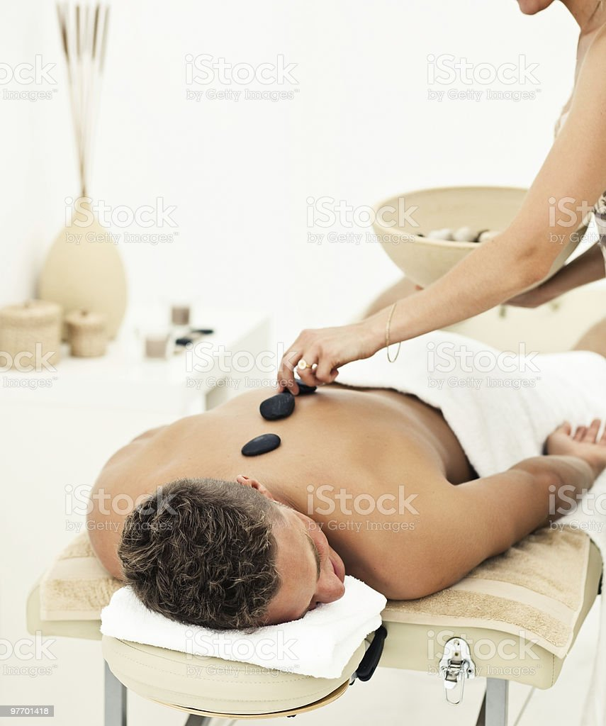 Young man getting spa treatment royalty-free stock photo