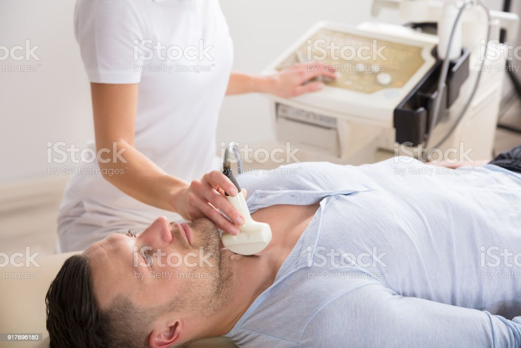 Young Man Getting Ultrasound Of A Thyroid stock photo