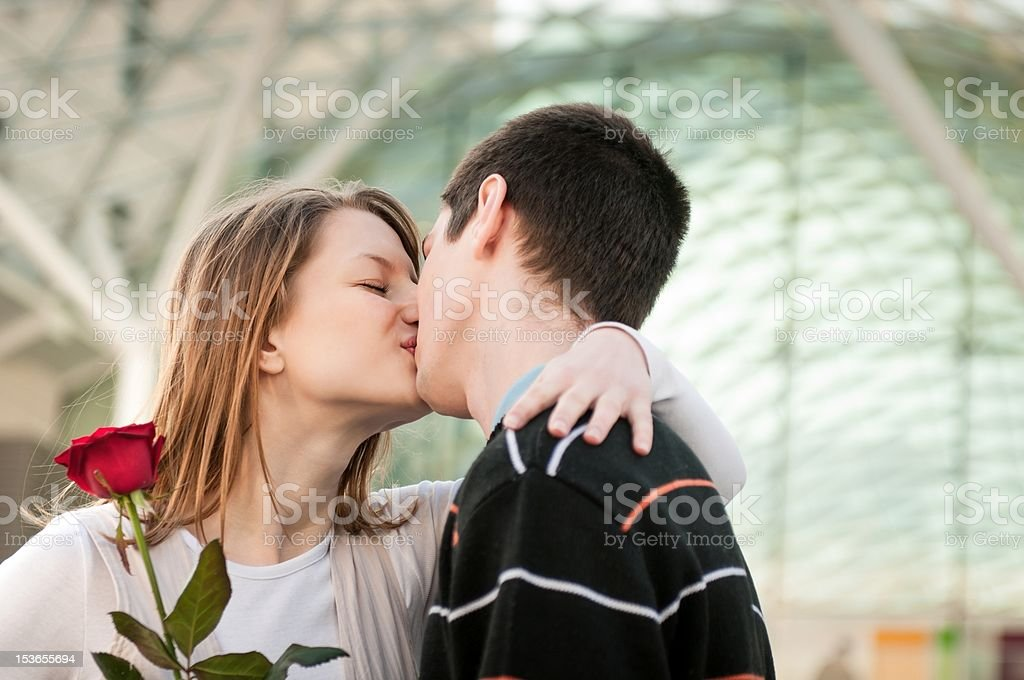 Young man giving a flower to woman royalty-free stock photo