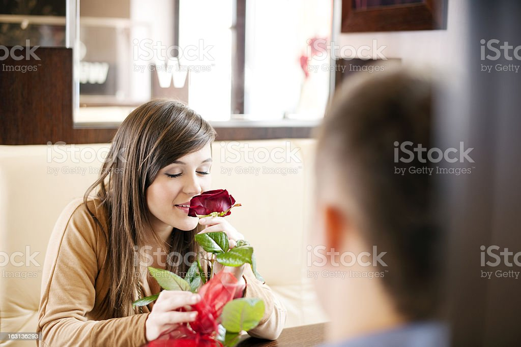 Young man giving a rose his girlfriend royalty-free stock photo