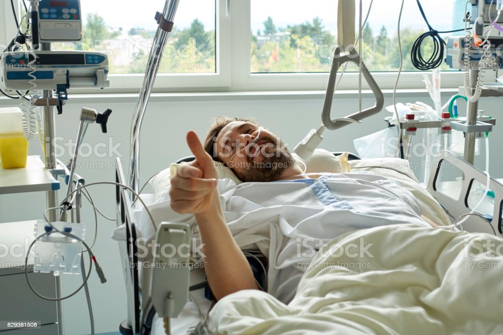Young man giving a thumbs-up after a Successful Surgery stock photo