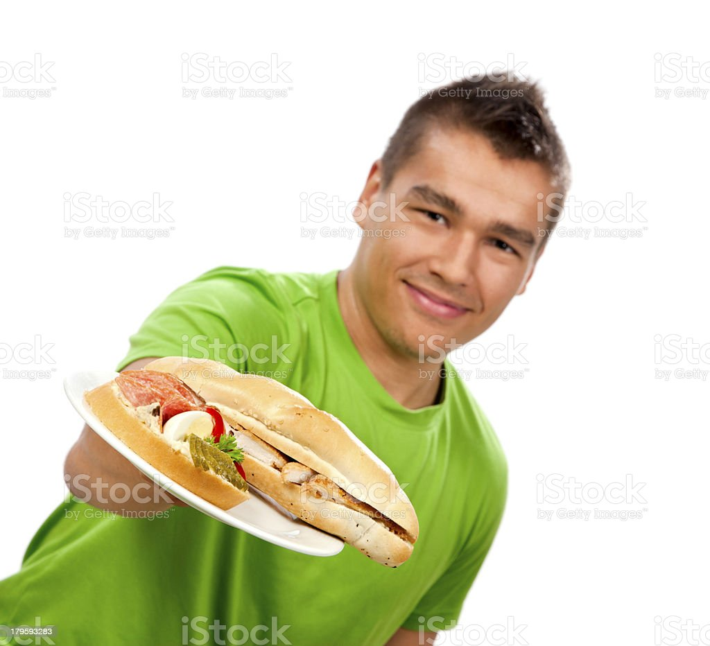 Young man giving sandwiches on a plate. royalty-free stock photo