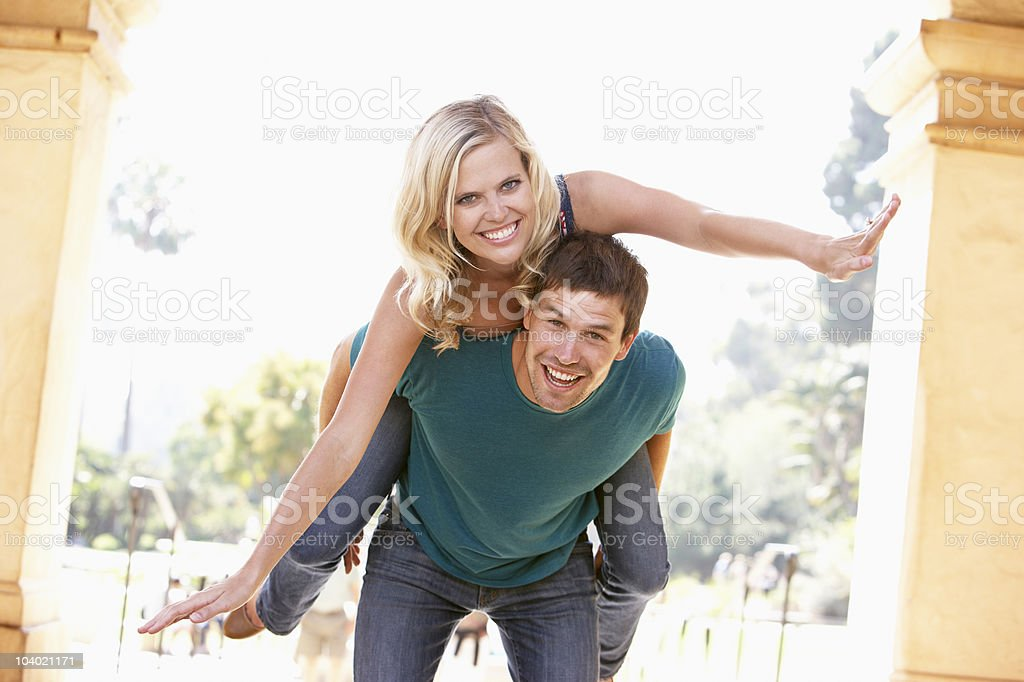 Young Man Giving Woman Piggyback royalty-free stock photo
