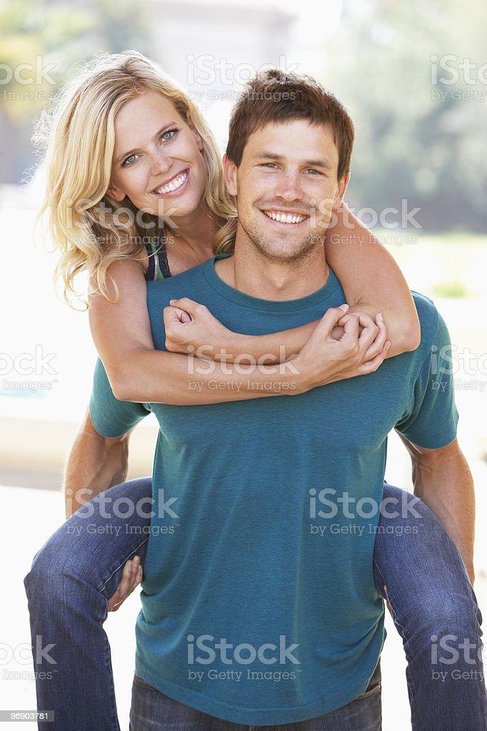Young Man Giving Woman Piggyback royalty-free stock photo