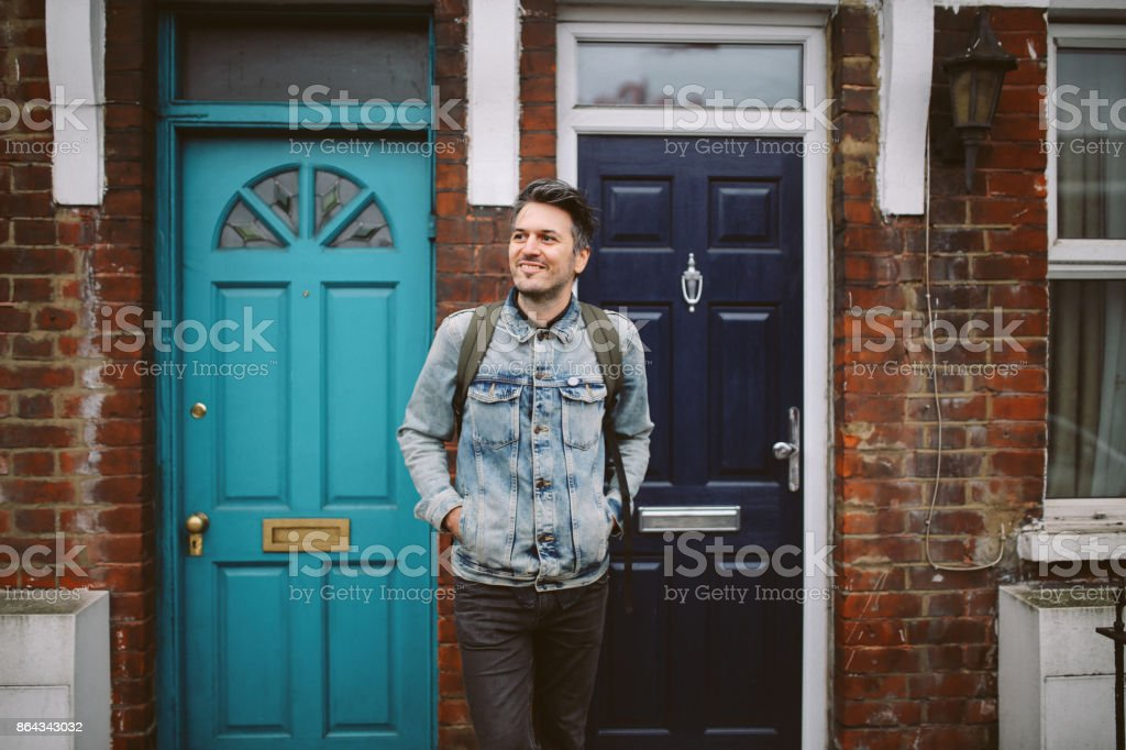 Young man going out to work from home stock photo
