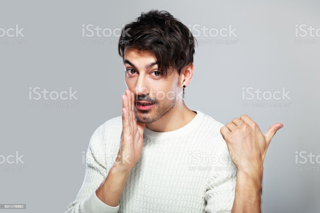 young man gossiping stock photo