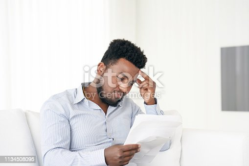 istock Young man got a bad letter uvolnenii 1134508095