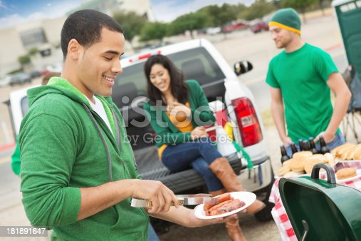 istock Young man grilling during tailgating party near football stadium 181891647