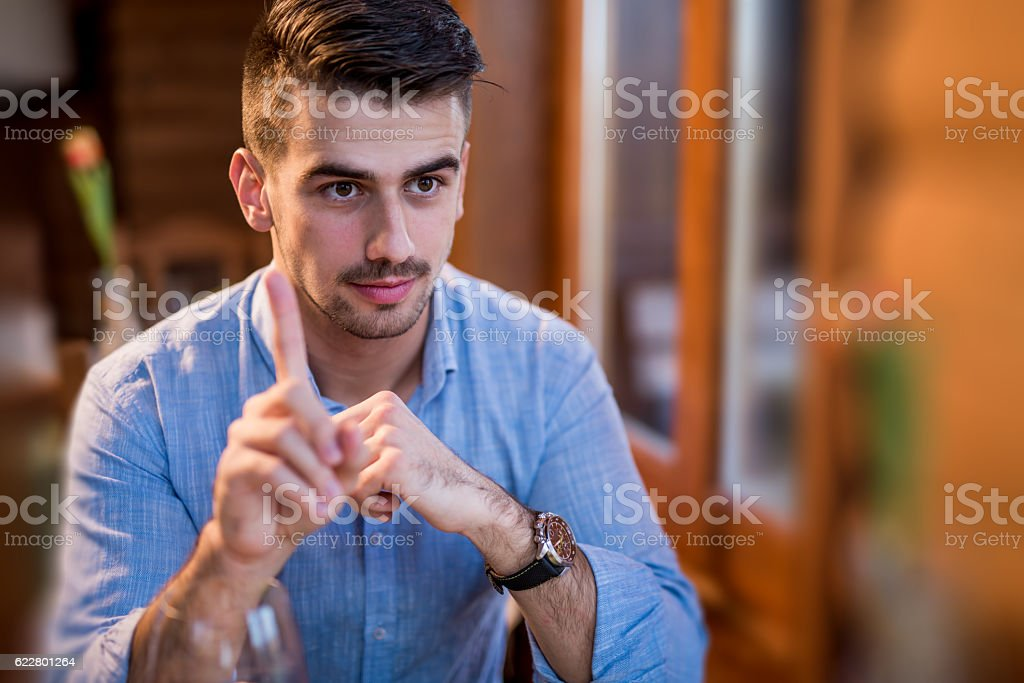 Young man hand gesturing and giving instructions stock photo