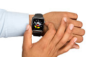 Young Man Hand Holding The Apple Watch