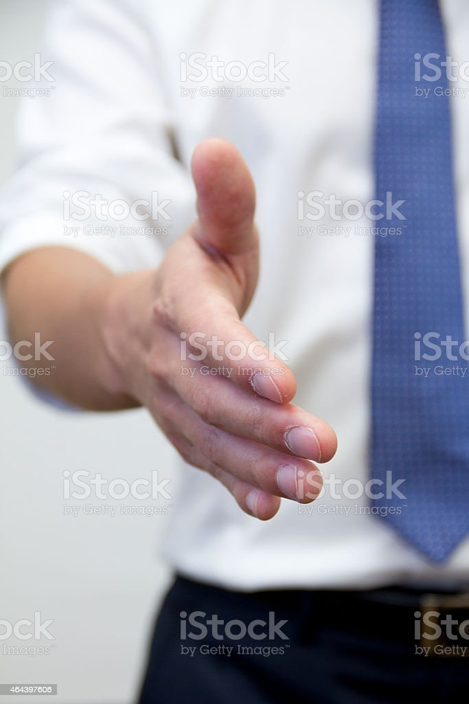 Young man Hand Shake for Greeting Or Agreement stock photo