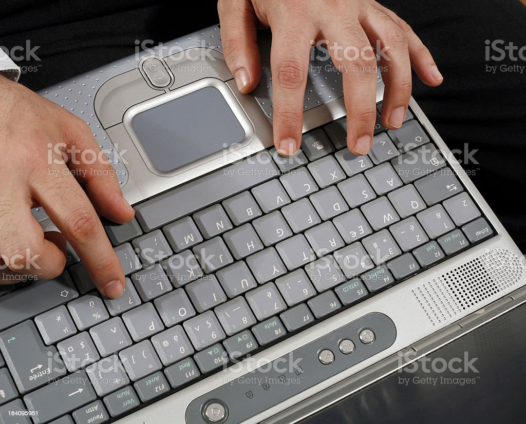 Young man hands writing on a laptop keyboard royalty-free stock photo