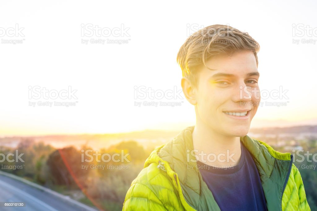 Young man hanging out by highway