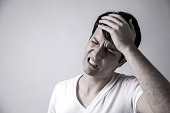 istock young man have a headache 810511870