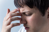 istock young man have a headache 810515260