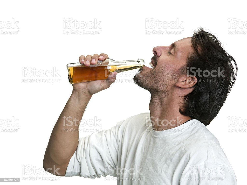 Young man having a beer stock photo
