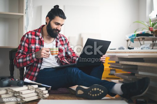 452592895 istock photo Young man having a coffee break at his new apartment 934706976