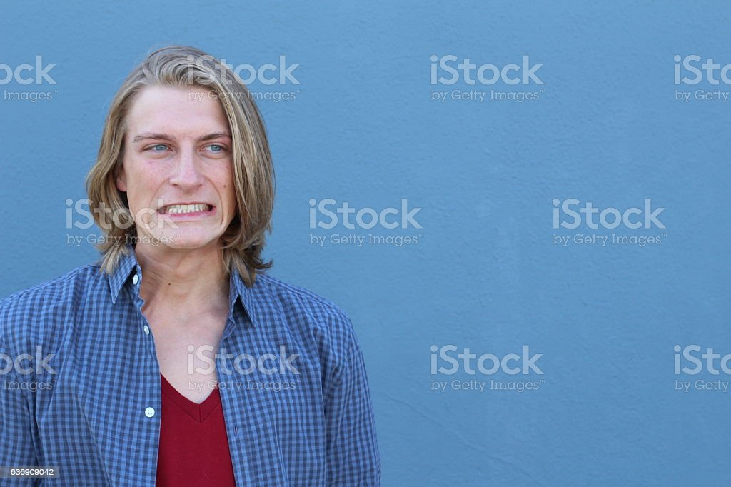 Young man having a duh moment isolated stock photo