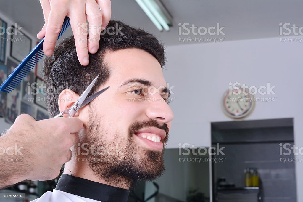 Young Man Having A Haircut With Scissors Stock Photo 597673240 Istock