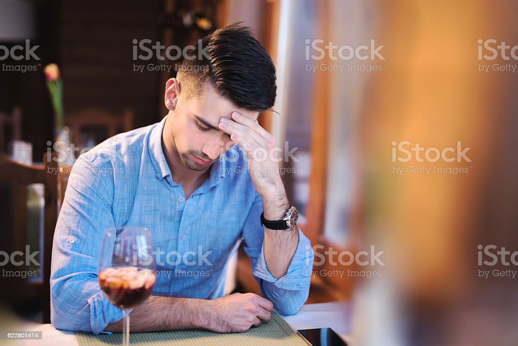 Young man having a headache on a meeting stock photo