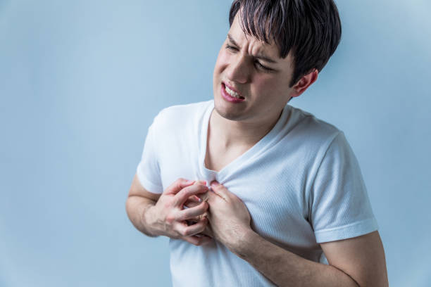 young man having a heart ache young man having a heart ache intercostal space stock pictures, royalty-free photos & images