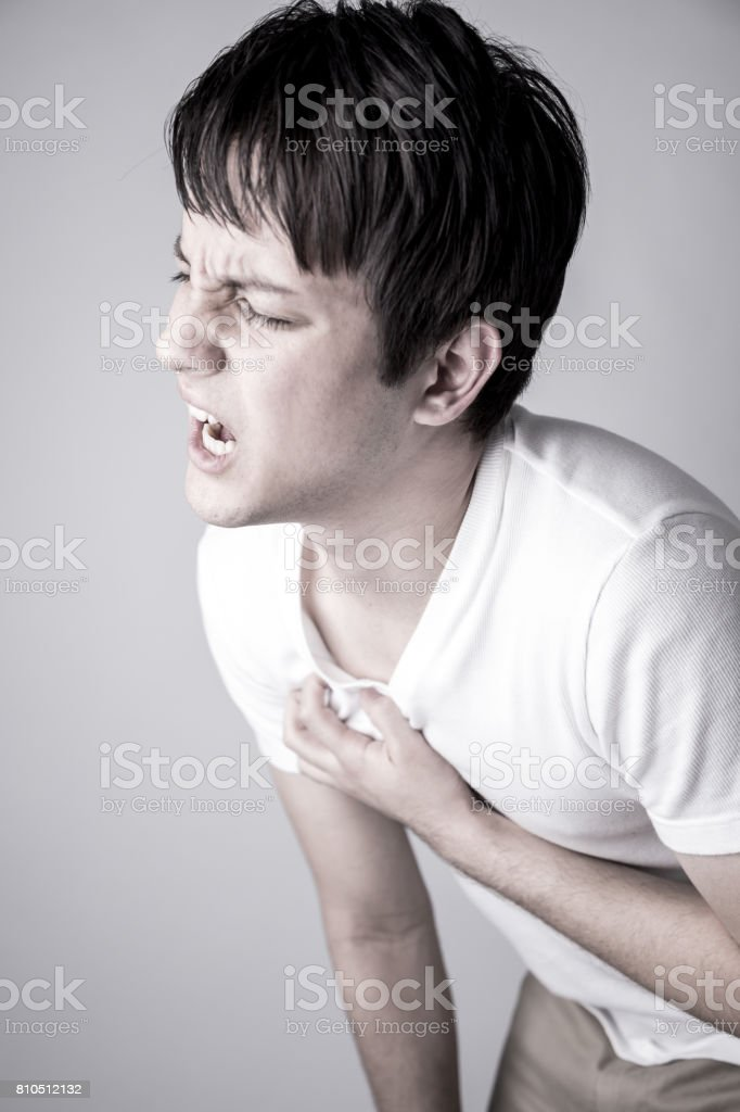 young man having a heart ache stock photo