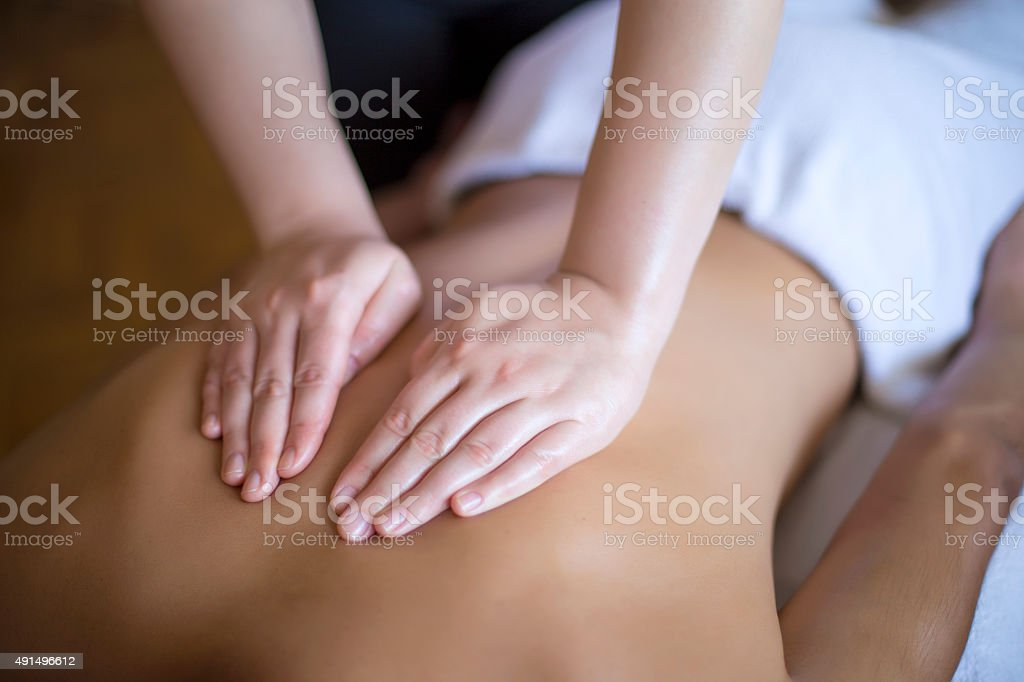 Young man having a massage stock photo