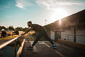 istock Young man having a sports exercise outdoors in the city 1138942116