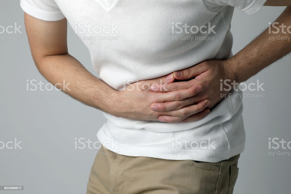 young man having a stomachache royalty-free stock photo