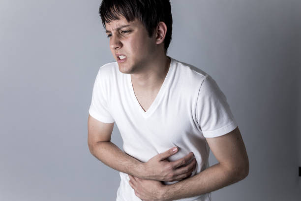 young man having a stomachache stock photo